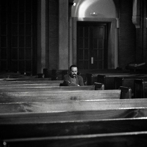 Processing the Morning News Inside a Church Image
