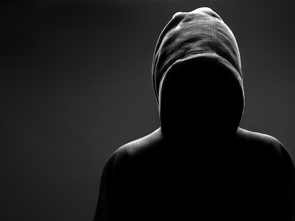 Hooded Figure Standing Over Me Image